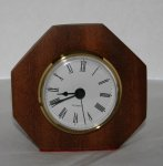 Mahogany Table Top Clock with white face and black numerals