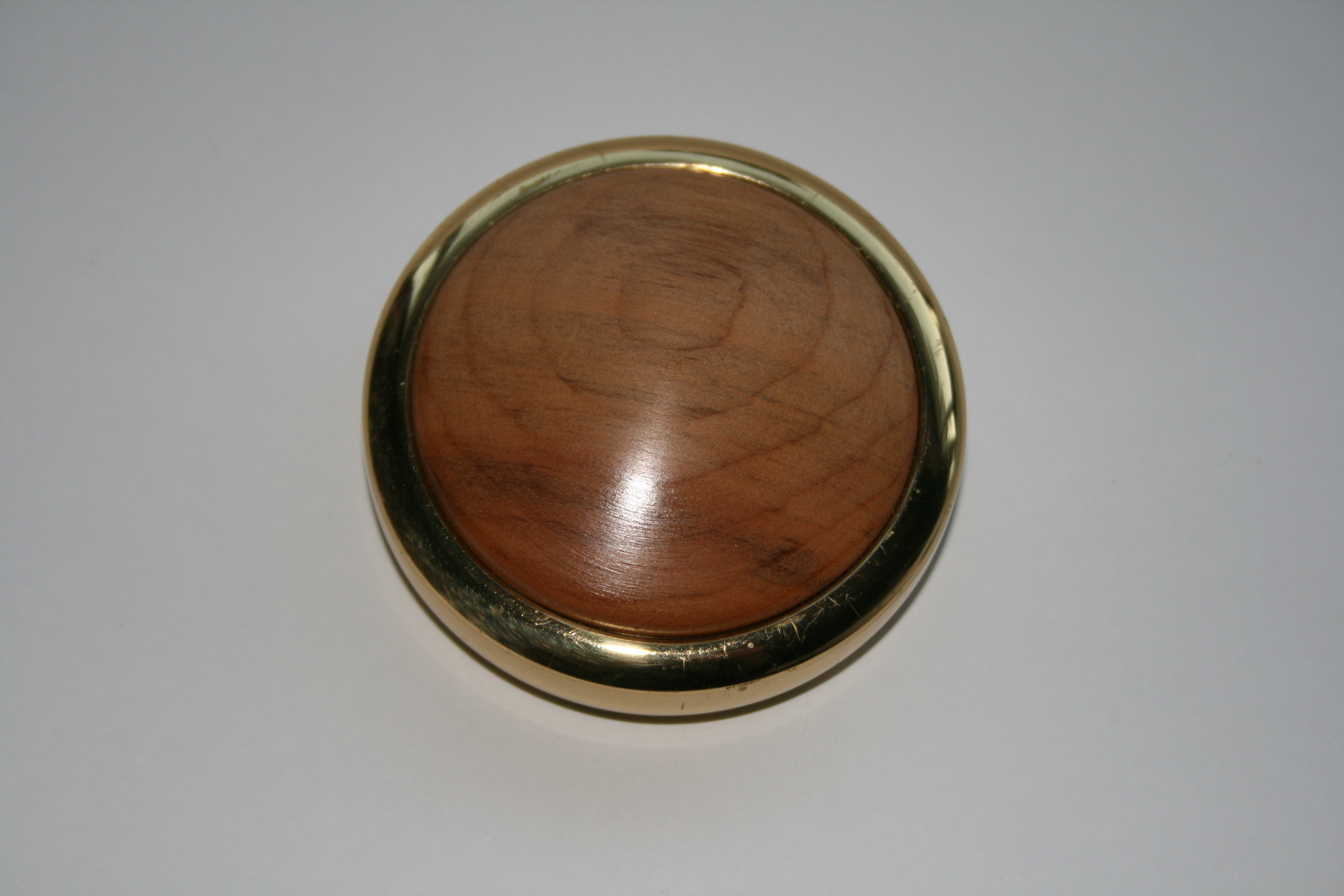 Round flat solid brass paperweight with Lacewood in the top
